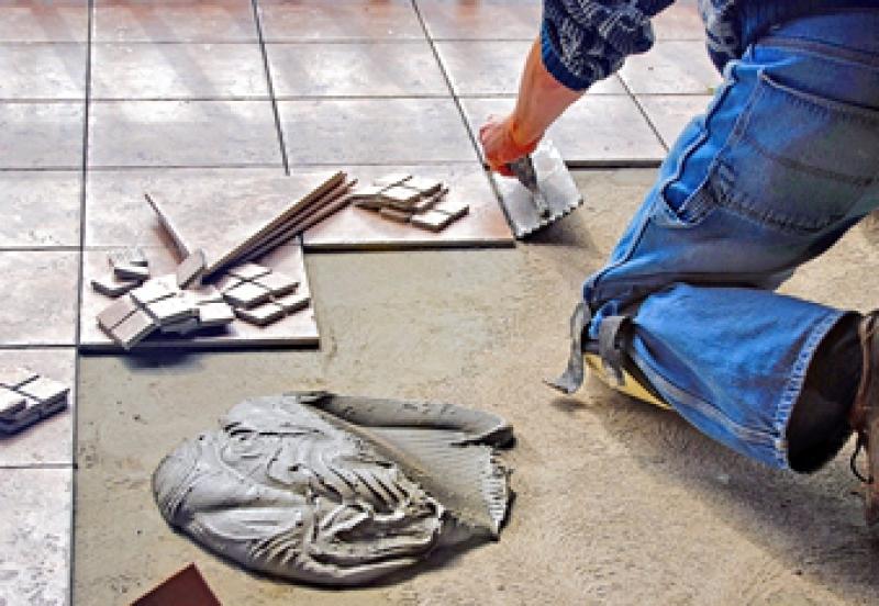 Porcelain floor tile being installed