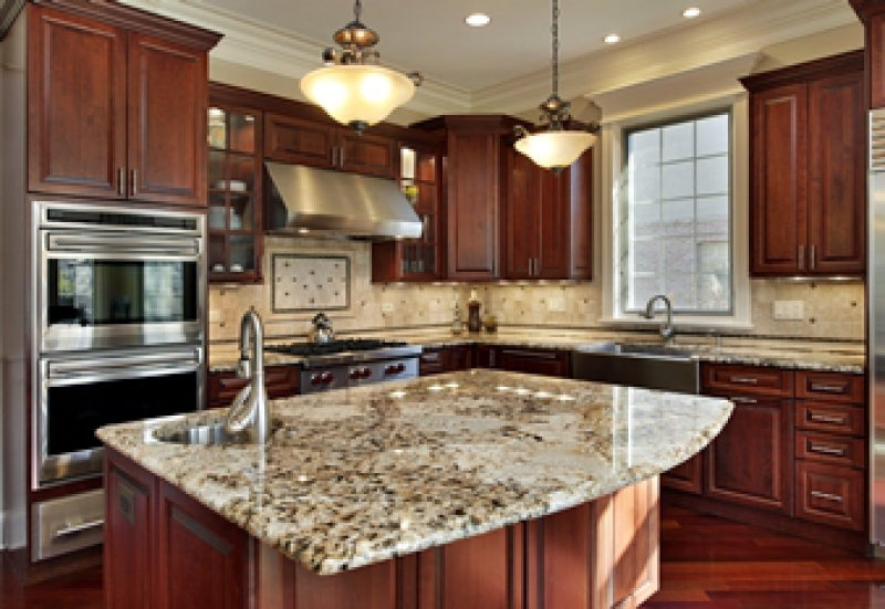 Remodeled kitchen with dark cabinets and granite countertops