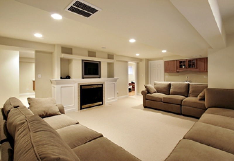 Renovated basement with sofas and entertainment center