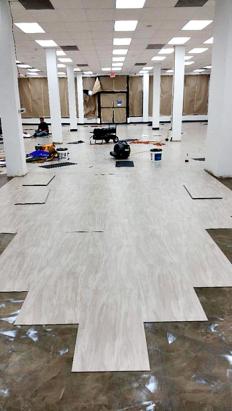 commercial retail floor glue-down flooring